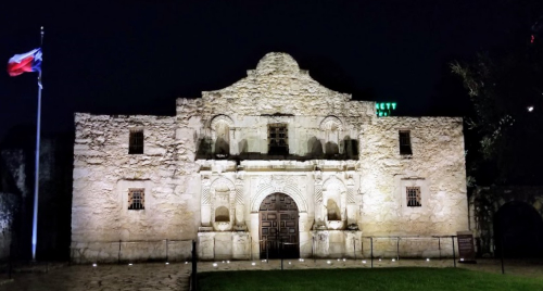 The Alamo at night with Texas flag, August 2019